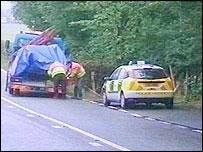 crash scene - car being taken away