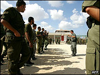 Palestinian policemen get ready at their base in Nusseirat town, south of Gaza city