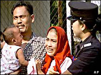 Acehnese family being deported, 2002
