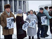 Protesters with Mikhail Marinich photos