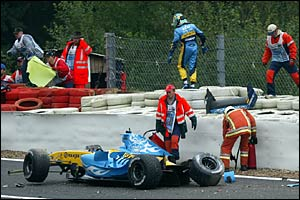Giancarlo Fisichella walks away after spinning out