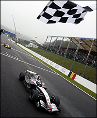 Kimi Raikkonen crosses the finish line