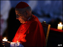 Spanish Cardinal Eduardo Martinez Somalo holds a candle in St-Peter's basilica at the Vatican, during the mass of Lighting of the candles