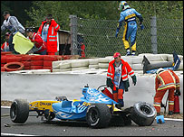 Giancarlo Fisichella walks away from the wreckage of his Renault