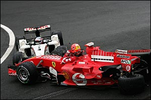 Takuma Sato (L) and Michael Schumacher (R) crash