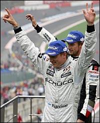Jenson Button follows Kimi Raikkonen onto the podium