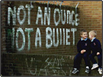 IRA graffiti behind two school boys