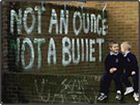 IRA graffiti behind two school boys