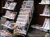 News stands displaying UK and foreign newspapers