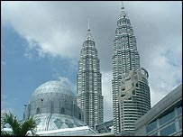 Mosque and Petronas towers in Kuala Lumpur