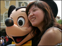 Visitor at the opening of Hong Kong Disneyland with Mickey Mouse