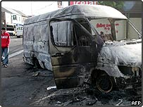 Burned out bus following night of rioting in Belfast