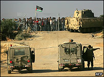 Palestinians confronting Israeli troops on Gaza border