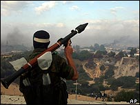 Palestinian militant looks down over former settlement of Neve Dekalim