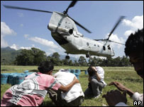 US helicopter dropping off food, AP
