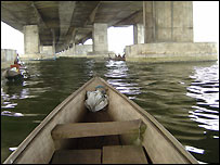 Canoe under a bridge in Lagos