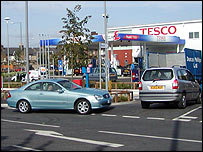 Cars queue for petrol