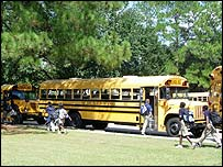 Students at Westdale Middle School in Baton Rouge board buses to go home