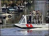US soldiers and coast guard patrol New Orleans in a boat
