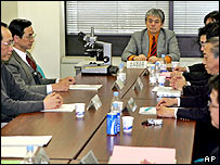 Members of Creutzfeldt-Jacob Disease Surveillance Committee of the Health, Labor, and Welfare Ministry, join in an emergency meeting in Tokyo Friday, Feb. 4, 2005