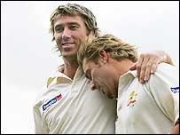 Glenn McGrath (left) and Shane Warne leave the field at The Oval after their final Test in England