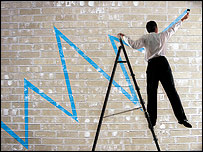Man on stepladder, painting graph on wall