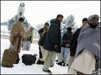 Passengers waiting to board a plane at Kabul international airport
