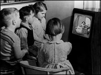 Children gathered around the television set, BBC