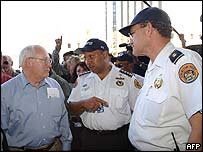 New Orleans police chief Eddie Compass (centre) with Vice President Dick Cheney (left)