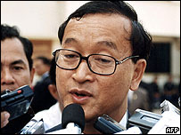 Cambodian opposition leader Sam Rainsy speaks to media prior to the National Assembly session in Phnom Penh, 03 February 2004