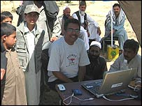 Soutik Biswas in the village with his laptop