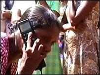 Tsunami victims use a satellite phone
