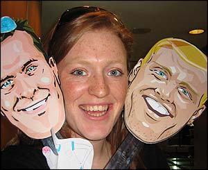 Cricket fan Lucy Brooks poses with Vaughan and Flintoff masks