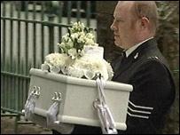 Sgt Jason Robinson carries the coffin into the church