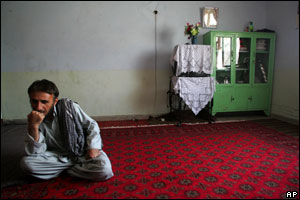 Returnee Mohammad Khan in his room in a Soviet-built cultural centre in Kabul, now home to dozens of refugees.