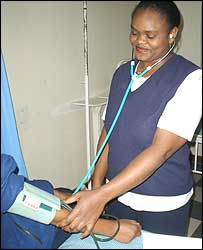 Nurse checking a mother-to-be's blood pressure