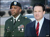 Sgt Javal Davis (left) arrives for sentencing with his lawyer, 4 February 2005