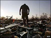 Mississippi man surveys remains of home