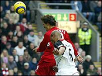 Fernando Morientes heads in Liverpool's first goal.