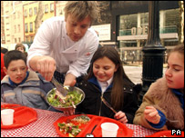 Jamie Oliver serving some children