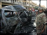 Iraqi soldier at bomb site in Baghdad's Kadhimiya district
