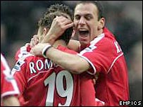 Radostin Kishisev congratulates Charlton scorer Dennis Rommedahl