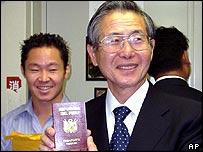 Peru's former President, Alberto Fujimori, shows his new Peruvian passport at the embassy in Tokyo