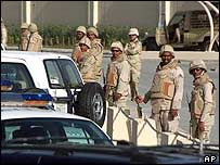 Saudi police stand on guard near the conference centre in Riyadh