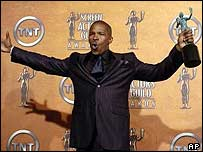 Jamie Foxx holds the award for outstanding performance at SAG Awards in Los Angeles