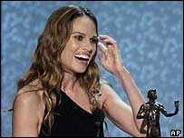 Hilary Swank reacts as she accepts her award in Los Angeles