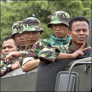 Indonesian soldiers look out from a truck during a drive through Banda Aceh, Indonesia, Tuesday, September 13, 2005.