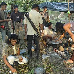 Members of the Free Aceh Movement (GAM) prepare a meal at their camp