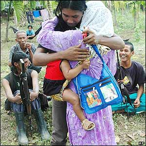 A member of the Free Aceh Movement (GAM) hugs a relative whom he hasn't seen in 5 years in Bireun, Aceh province, Indonesia Tuesday Sept. 13, 2005