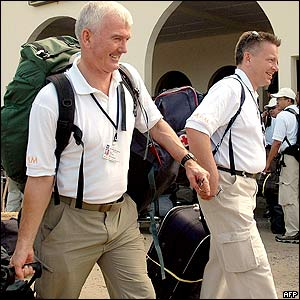 Unidentified Aceh Monitoring Mission (AMM) members arrive at Iskandar Muda airport in Banda Aceh, 13 September 2005.